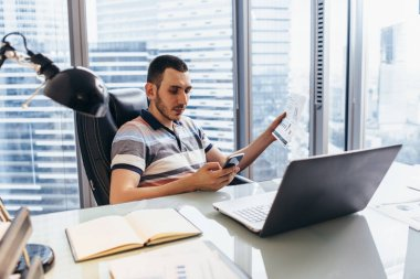 Workday of financial analyst typing on computer analyzing working with statistics sitting at workplace against window with cityscape view