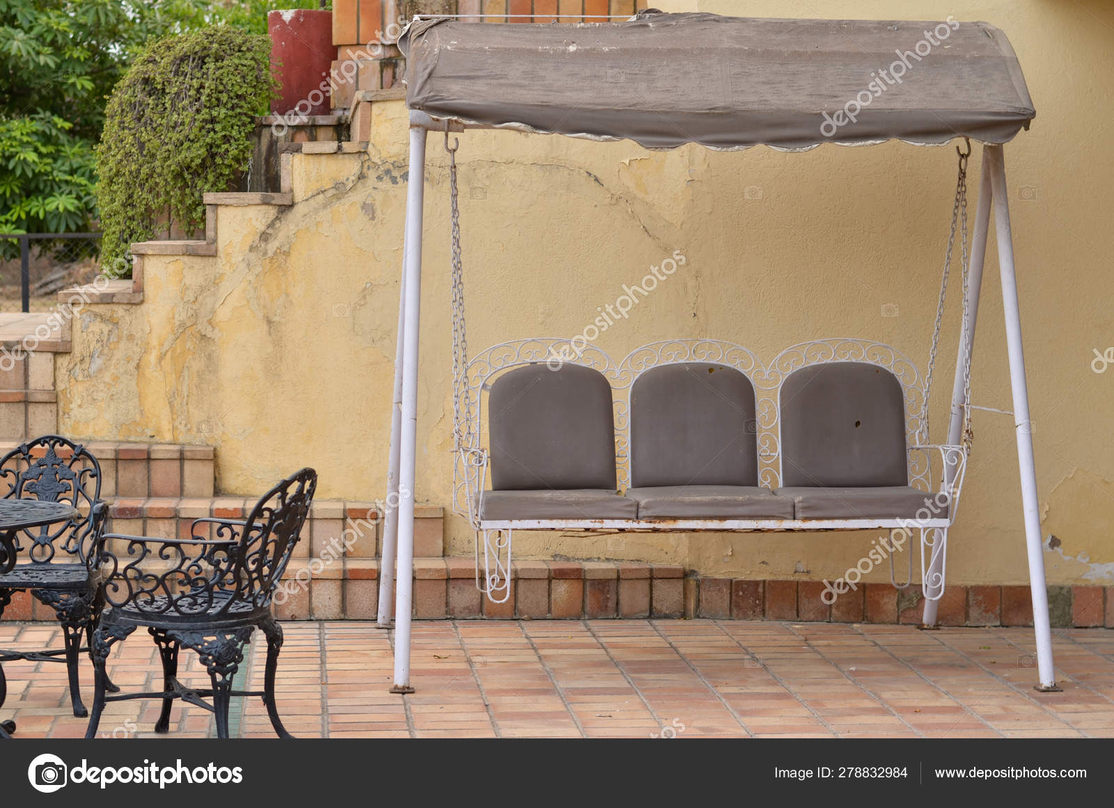 Picture of: Wrought Iron Dining Table Chair Kept Patio Swing Iron Background Stock Photo C Jayantbahel 278832984