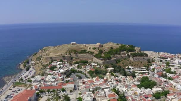 Aerial drone photo of unique Venetial castle of Fortezza built on a hill called Paleokastro by the sea in the heart of picturesque city of Rethymno, Crete island, Greece