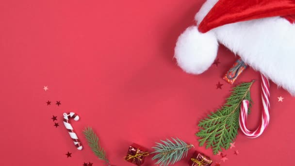 Christmas background 360 degree rotation. Santa Claus hat with decoration and fir tree branches spinning on red background. Concept of New Year presents, festive and holiday shopping