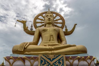 Big Buddha statue at cloudy sky background in temple on Koh Samui, Thailand