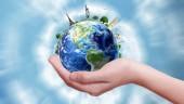 ženská ruka drží zemi světa, 3d obrázek