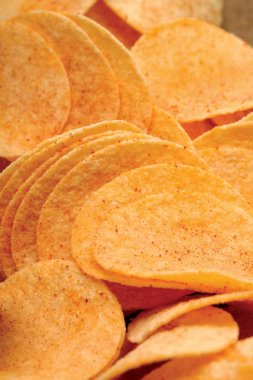 Crowded potato chips. Salty and crunchy.