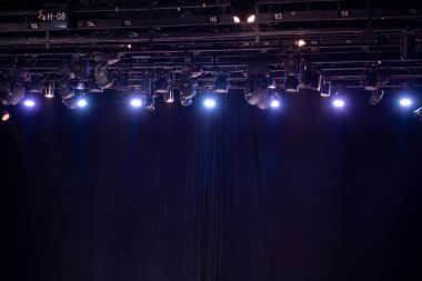 Lighting equipment and hanging bars for performances within the theater are bright for use.
