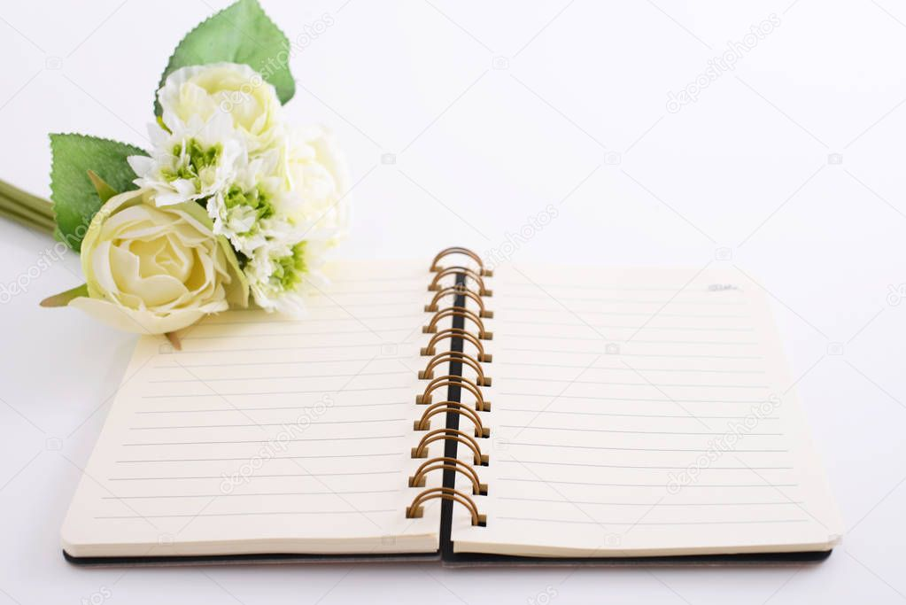 Ring binder book with flowers on the desk