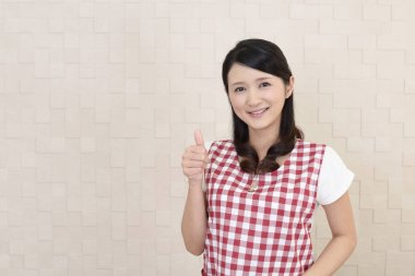Happy Asian housewife in apron