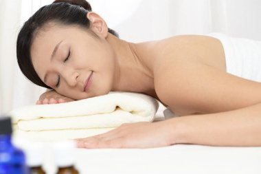 Woman relaxing at spa salon