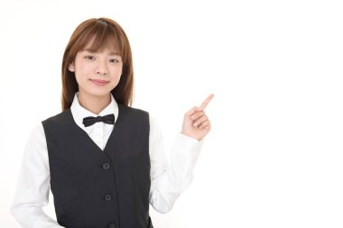 Asian waitress pointing with her finger