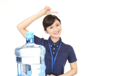 Female worker with a container of water
