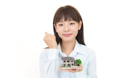Woman with a housing model