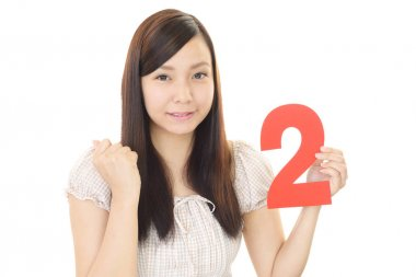 Woman holding number two