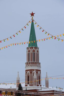 Nikolskaya tower at Red square in the frame of the colorful christmas lights.