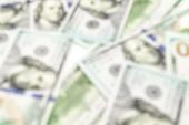 Mi dollár elvont elmosódott háttér. Amerikai USA pénz, 100 száz papír készpénz lágy fókuszban, USD számla
