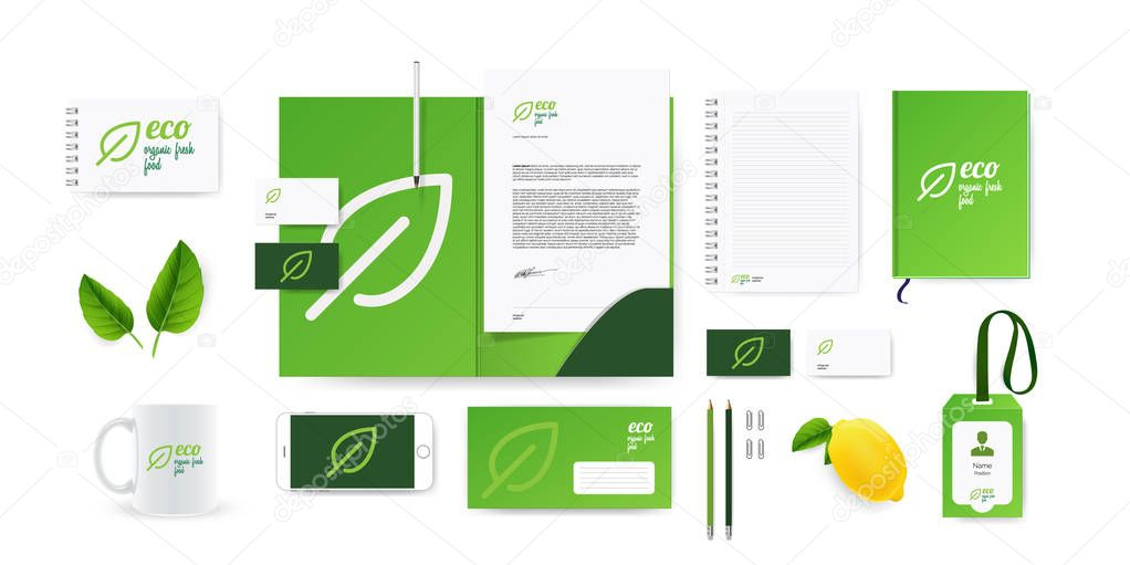 Corporate branding identity mockup set for natural eco company, vegan restaurant or food and flower shop. Green vector logo template and stationary mockup with mint and lemon.