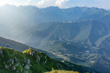summer view from the top of the Aibga range to the Rosa Khutor ski resort. Krasnaya Polyana, Sochi,, Russia.