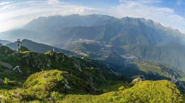 Panoramic view from the top of the Aibga ridge at the ski resort. Krasnaya Polyana, Sochi, Caucasus, Russia.