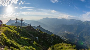 Panoramic view from the top of the Aibga ridge at the ski resort. Krasnaya Polyana, Sochi, Caucasus, Russia.