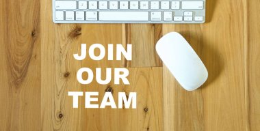 Join our team, words printed on desktop