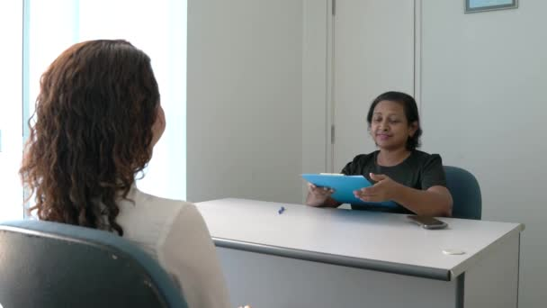 Recruiter or Job Interviewer conducting an interview with a job seeker in an office room. Employment or hiring concept.