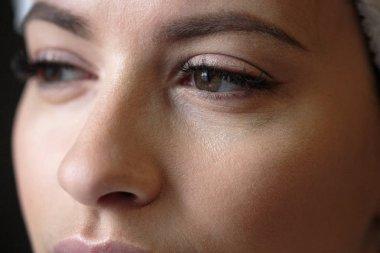 Closeup macro photo of woman's eyes with long lashes and natural makeup