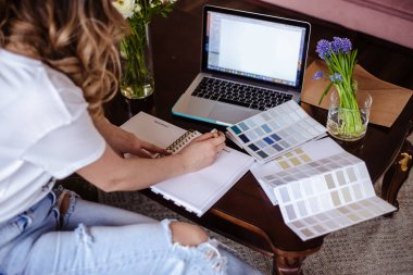 Decorator young woman works with color palette, lifestyle casual photo
