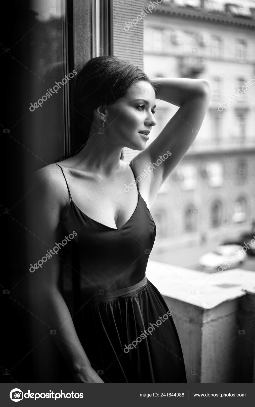 Black white portrait young woman elegant silk black dress lookingto