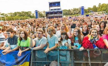 KIEV, UKRAINE - JULY 04, 2018: Fans crowd enjoy Belgian DJ Lost Frequencies live performance at the Atlas Weekend Festival in National Expocenter.