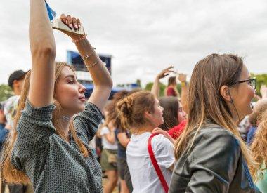KIEV, UKRAINE - JULY 04, 2018: Fans crowd enjoy Belgian DJ Lost Frequencies live performance at the Atlas Weekend Festival in National Expocenter.
