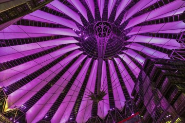 BERLIN, GERMANY - NOVEMBER 13, 2018: Night inside view on the spectacular roof construction of the Sony Center on Potsdamer Platz. It is a Sony sponsored building complex designed by Helmut Jahn.