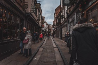 YORK, ENGLAND, DECEMBER 12, 2018: people walking in the famous The Shambles street.