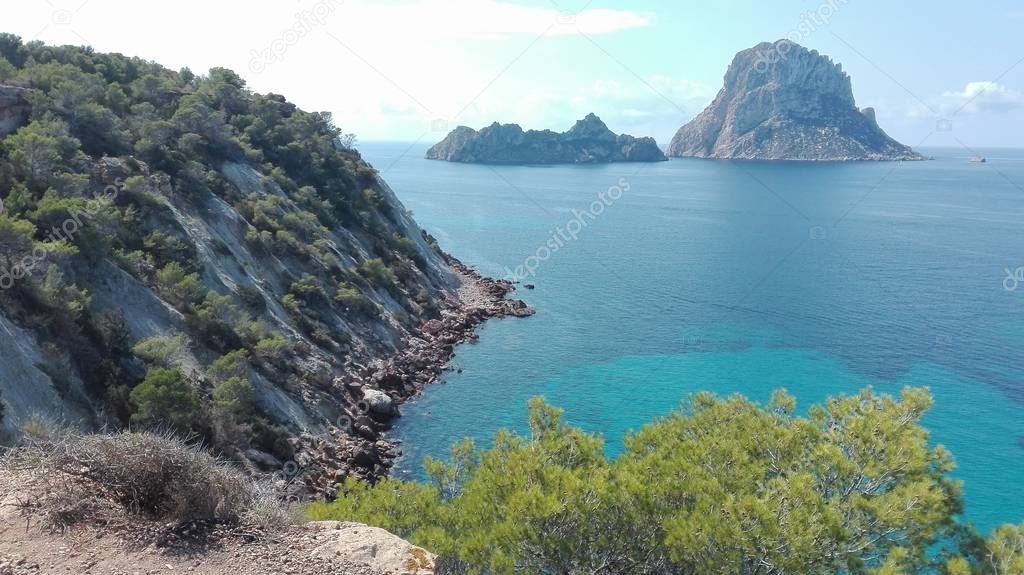 Es Vedra, the magical island of Ibiza, a tourist destination for hippies and explorers. breathtaking view off the coast of Cala D'Hort, famous ibizan beach