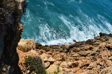 Rocky coastline with a bright turquoise colour of the Mediterranean Sea in Spain