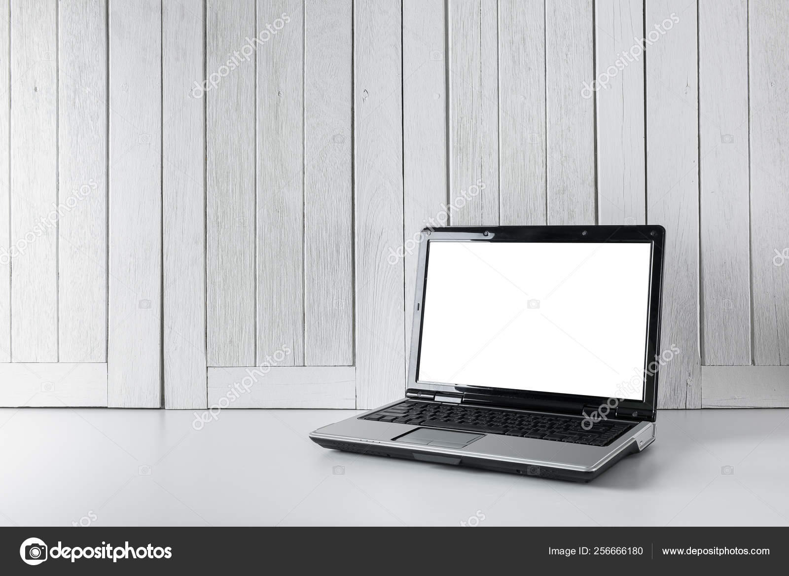 Workplace background with Blank white screen modern laptop