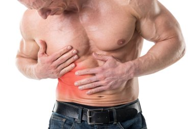 Closeup of shirtless man with belly pain over white background