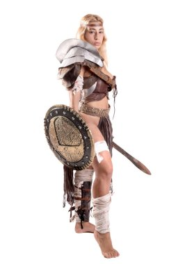 Ancient woman warrior or Gladiator posing with sword and shield, isolated in white stock vector