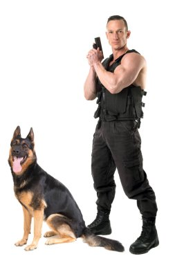 Police dog and agent with tactical vest and gun isolated in white