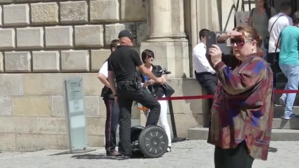 Krakow, Poland - May 5, 2018: Police officer on segway. Segway passes among tourists.