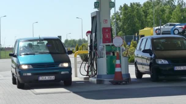 Brno, Czech Republic - May 6, 2018: The man is fueling the car in the gas station near the city.
