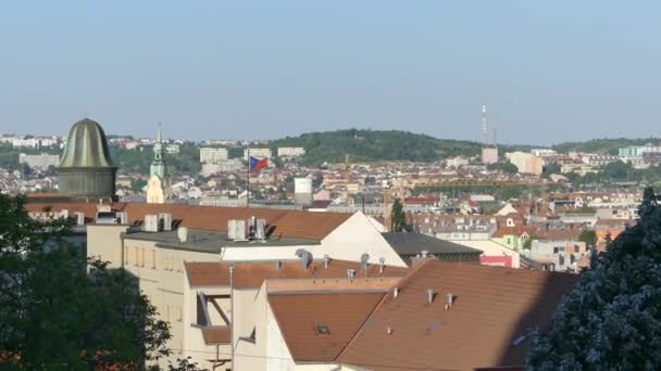 Brno, Czech Republic - May 6, 2018: A view of the architecture of the old city. The flag of the Czech Republic is developing in the wind against the backdrop of the city