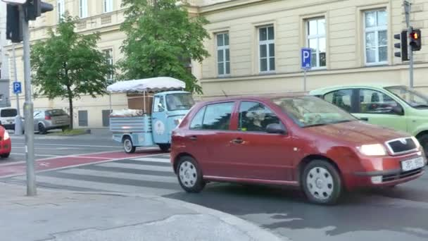 Brno, Czech Republic - May 6, 2018: A three-wheeled retro car rides along the street of the old city.
