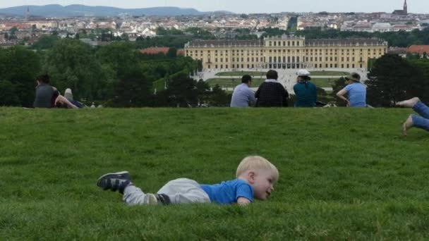Vienna, Austria, - May 2018: Schonbrunn Park. Tourists walk in the park near the Schonbrunn Palace. View of the palace.