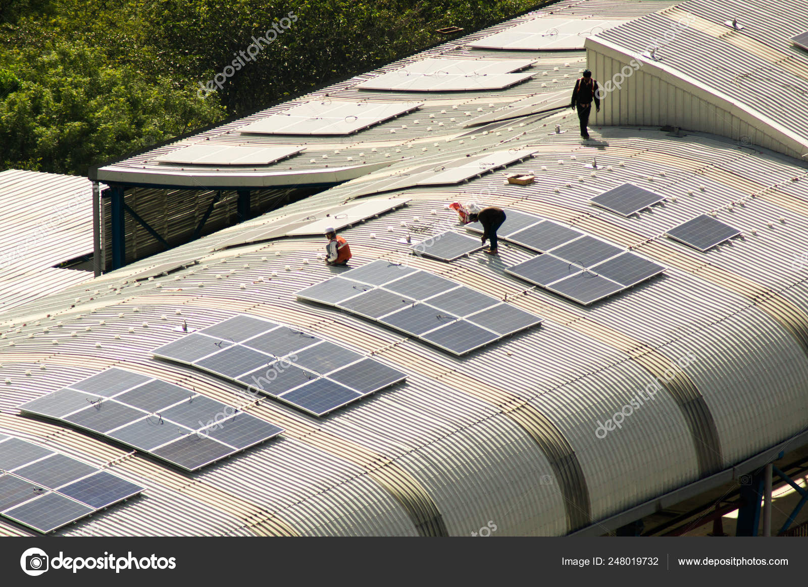 Solar panels being installed on the roof of delhi metro