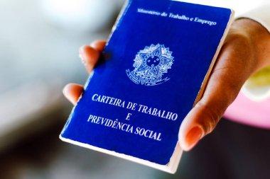 July 4, 2020, Brazil. Woman holds his Brazilian document work and social security (Carteira de Trabalho e Previdencia Social) stock vector