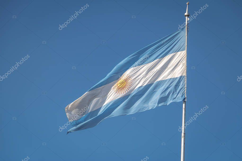 Argentina Flag waving on a blue sky