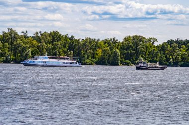 White pleasure boat floats on the river river.