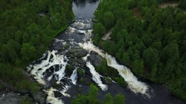 Long shot of unesco waterfall treshold deep in the Russian forests