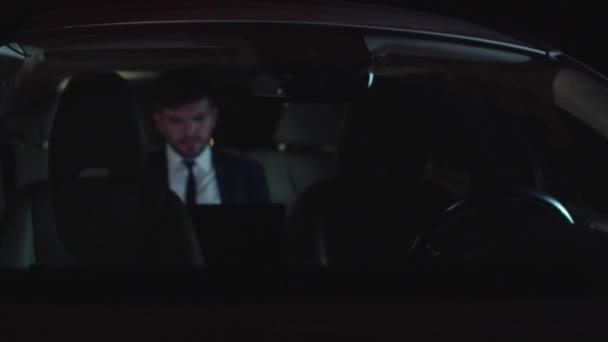 Man drive in self-driving car at night.