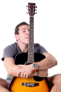 young man posing with guitar, isolated