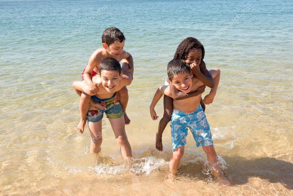 little kids posing at the beach