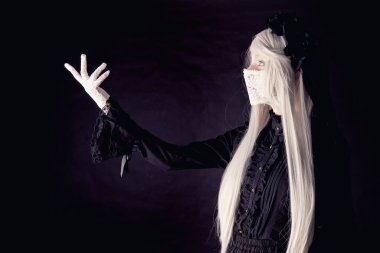 Creepy human doll isolated on a dark background stock vector